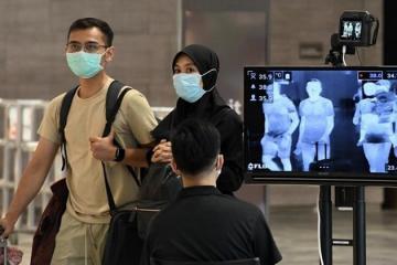 Số ca nhiễm Covid-19 tăng kỷ lục trong một ngày, Singapore cấm khách du lịch nhập cảnh